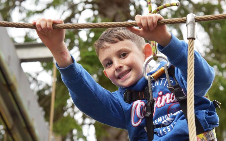 nathan climbing at Carrbridge